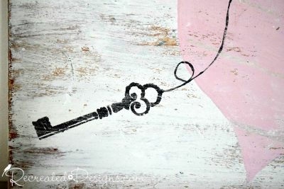 painted key on reclaimed wood painted white