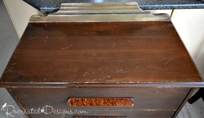 top of a vintage dresser with lots of scratches