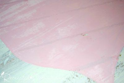 adding wax lines to a pink heart