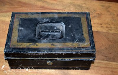 old tin black and gold cashbox