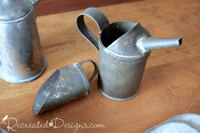 old tin scoop and oil can