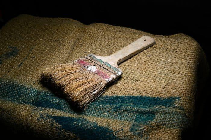 very old paint brush on burlap