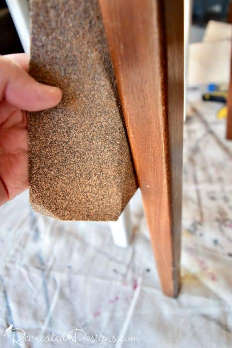 giving a light sanding to dining room chairs before painting them