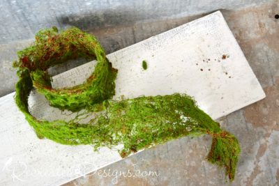 moss ribbon from Michaels on reclaimed wood