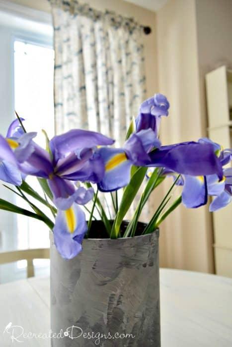 purple spring flowers in a painted vase