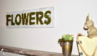 Moss covered flowers Spring sign with a silver cup and bunny
