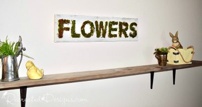 Flowers reclaimed wood sign above a board shelf