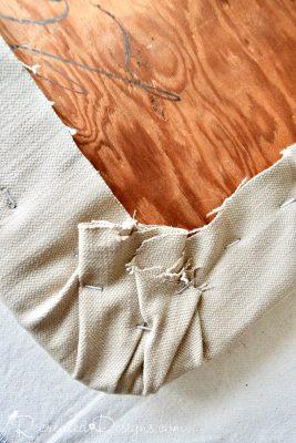 attaching fabric around the corner of a seat