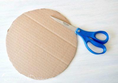 a circle cut out of a cardboard box
