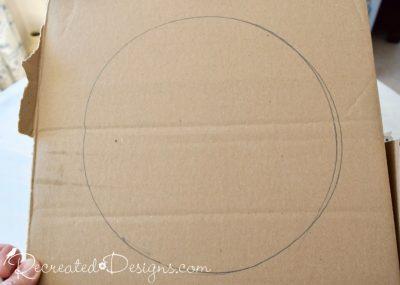 a circle drawn on a piece of cardboard