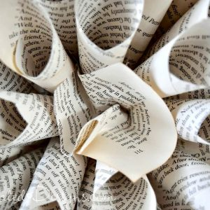 attching a centre to a paper flower made from book pages