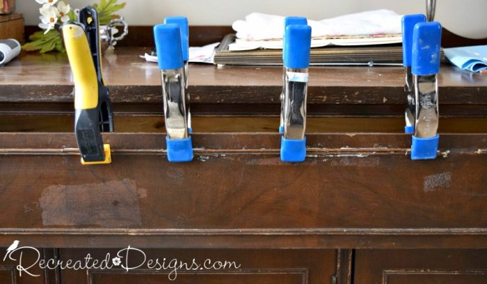reattaching trim on a vintage buffet