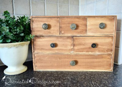 Pine IKEA storage transformed with reclaimed knobs and Gel Stain from General Finishes