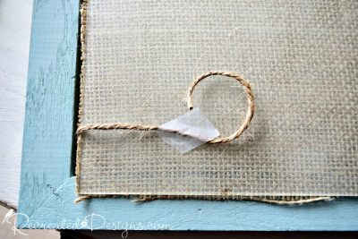 attaching burlap twine to hang pictures on