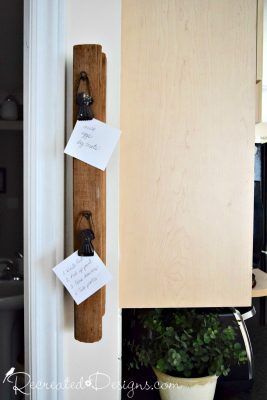 using an old piece of oak banister to hold memos