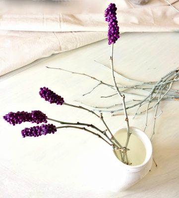 drying hot glue and beads on painted twigs