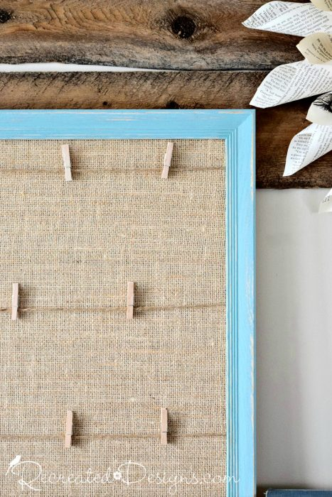 small clothes pins added to twine on memory board