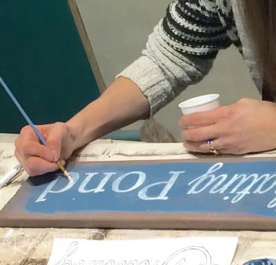 making a handpainted sign during a class taught by Lisa Silfwerbrand at Malenka Originals in Ottawa, Ontario