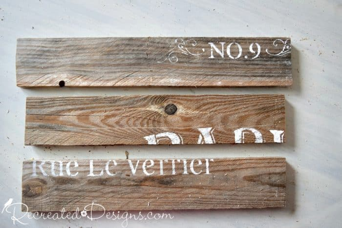 adding stencilling to reclaimed pallet wood