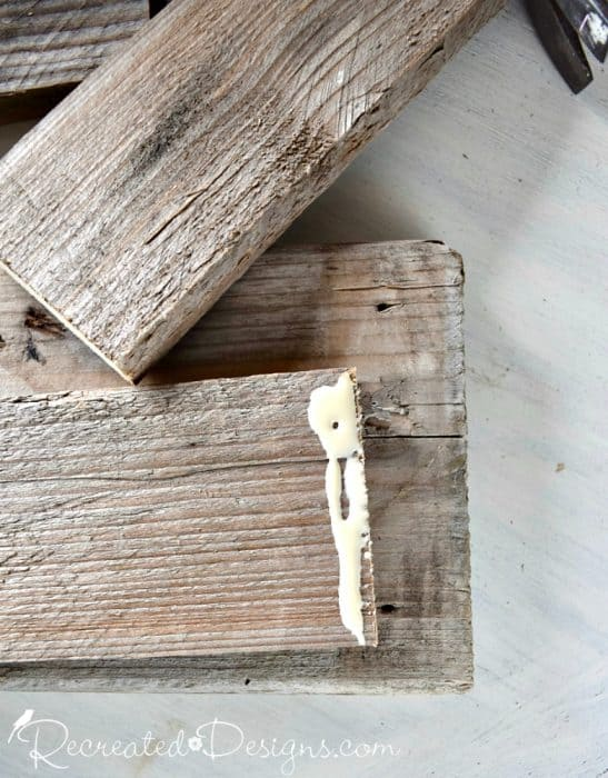gluing and nailing reclaimed pallet wood