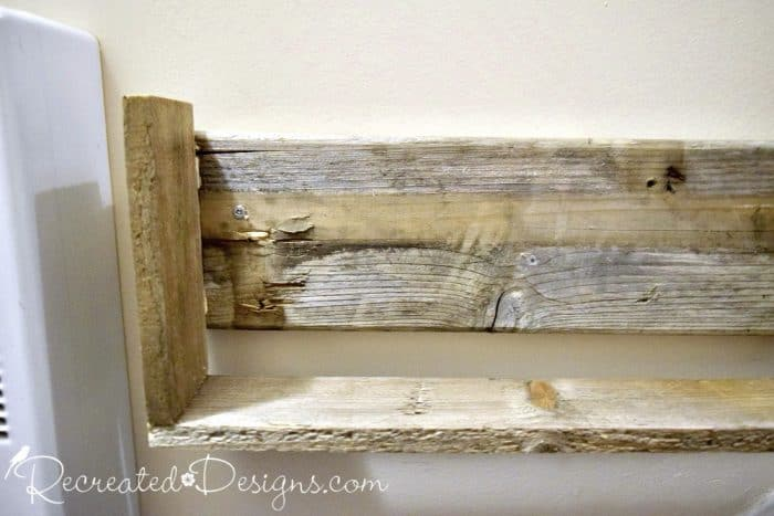 attaching pallet wood boxes to the wall to maximize the space in an entryway