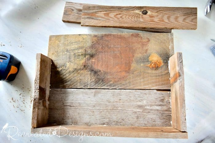 wooden shoe rack made from pallet wood