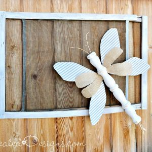 a summer bug made out of reclaimed items including an old spindle