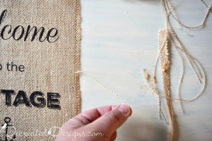 removing burlap threads to create a loose edge