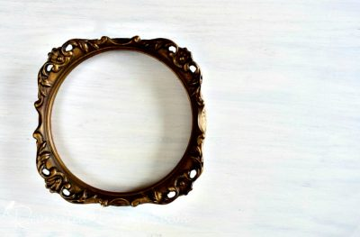 old round ornate gold frame