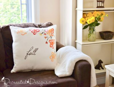 Fall pillow cover from IKEA transformed with the end of a celery stalk and paint
