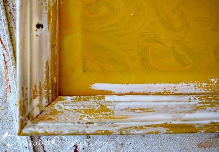 applying layer of glue over yellow paint to get crackle effect