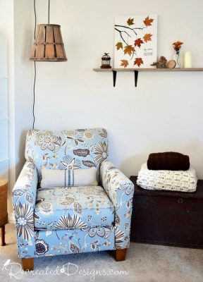 Fall art with leaves with rustic basket lamp
