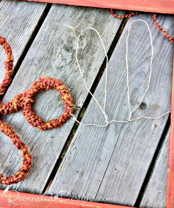 wrapping wire with yarn