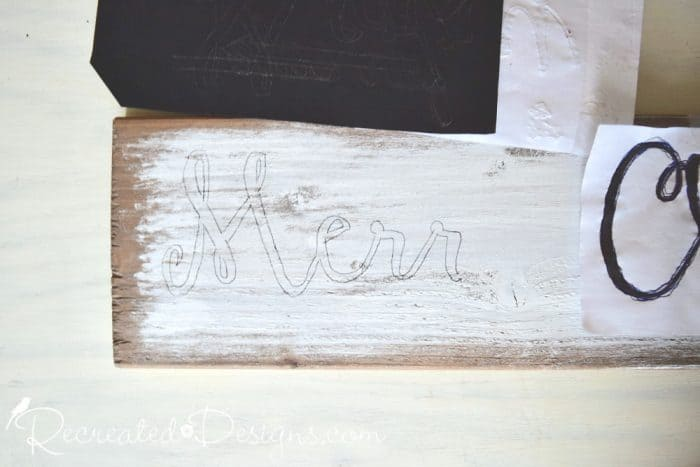 the outline of Merry Christmas after tracing the printed out text