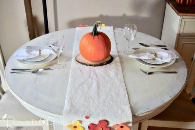 pumpkin on a fall table runner