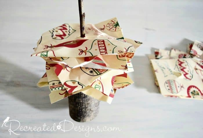 stacking paper squares onto a twig