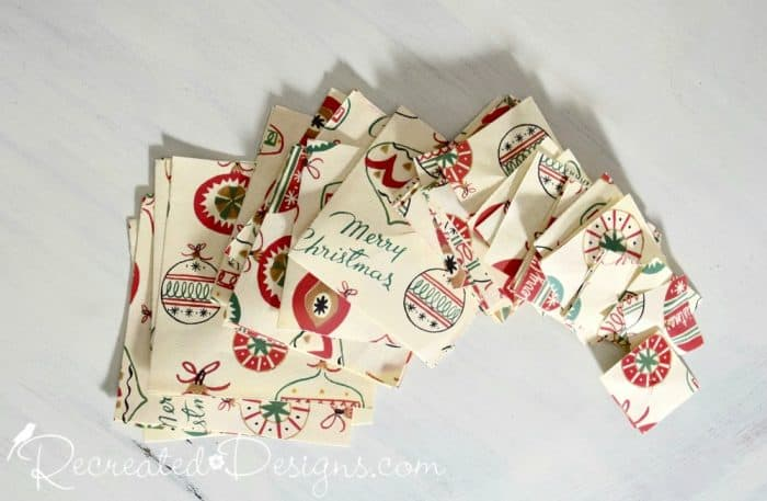 Christmas paper cut into various sizes of squares