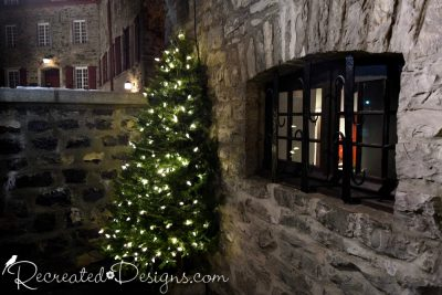 Christmas tree and stone buildings in Old Quebec City, Canada