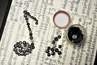 vintage buttons arranged as a music note