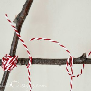 red and white IKEA twine wrapped around twigs