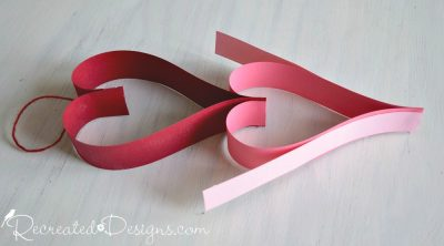 adding hearts to a Valentine paper garland by Recreated Designs