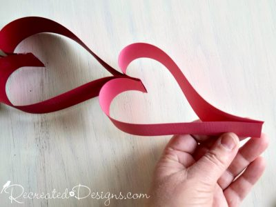 finishing paper hearts for a garland by Recreated Designs