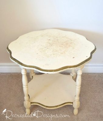badly damaged vintage side table