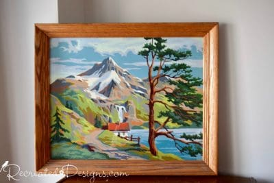 vintage paint by number cabin with mountains in the background