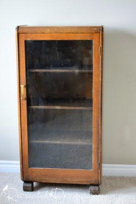 vintage art deco bookshelf with glass door