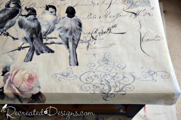 measuring vintage inspired postcard paper to cover nightstand top