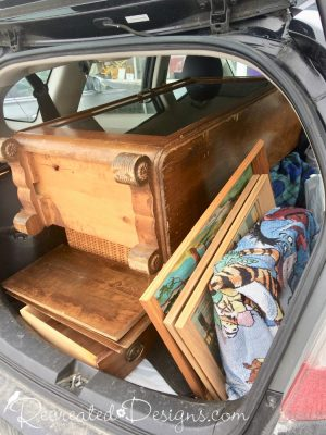 vintage finds piled in the back of a Honda