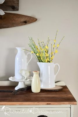 hand crafted jugs and Yellow Spring flowers