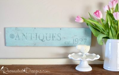 Antiques sign painted with Miss Mustard Sed Milk Paint and stamped with IOD stamps