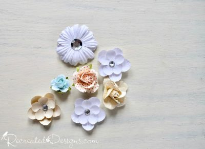 paper flowers in various shades of white and beige